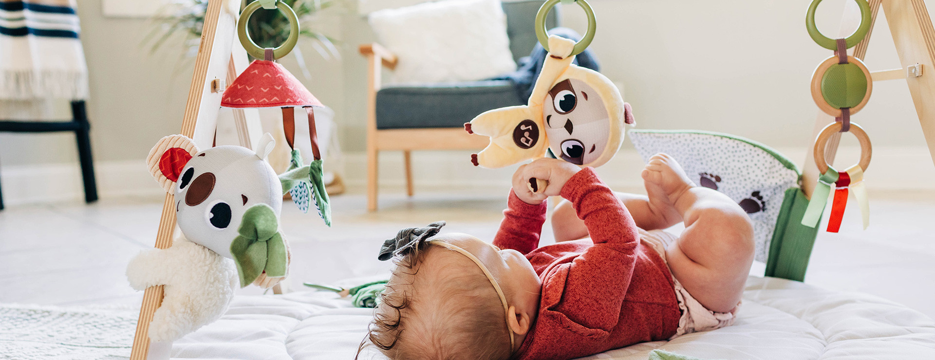 Baby-activated musical sloth supports cognitive development