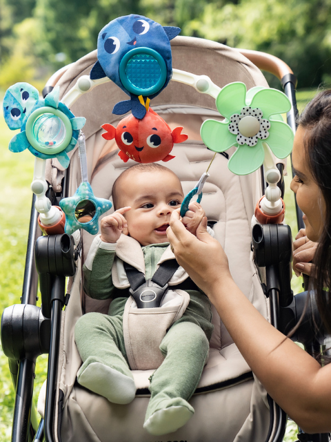 Baby-activated propeller spins when baby pulls the handle, supporting cognitive development
