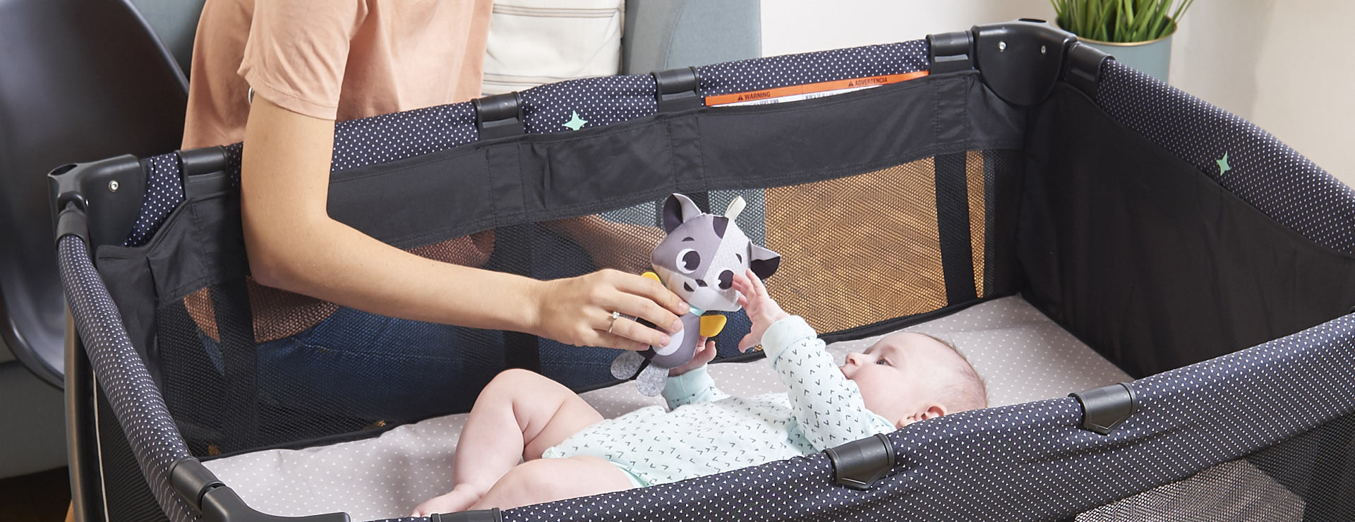 Play bassinet provides a secure place for babies up to 15 lbs.