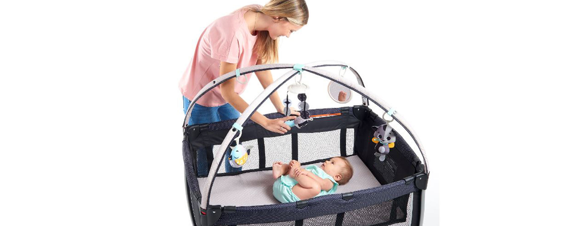 Versatile All-in-one Deluxe Play Yard and Play Mat keeps baby safe and entertained