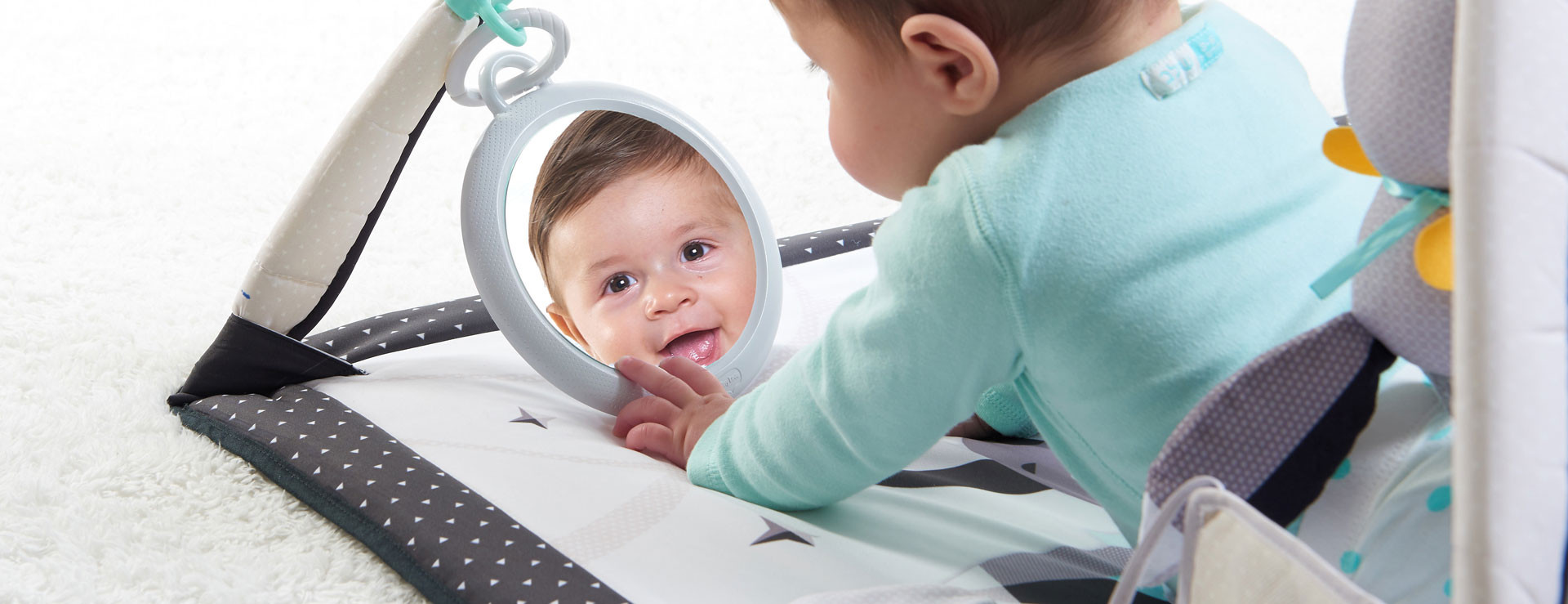 Engaging mirror helps extend tummy time