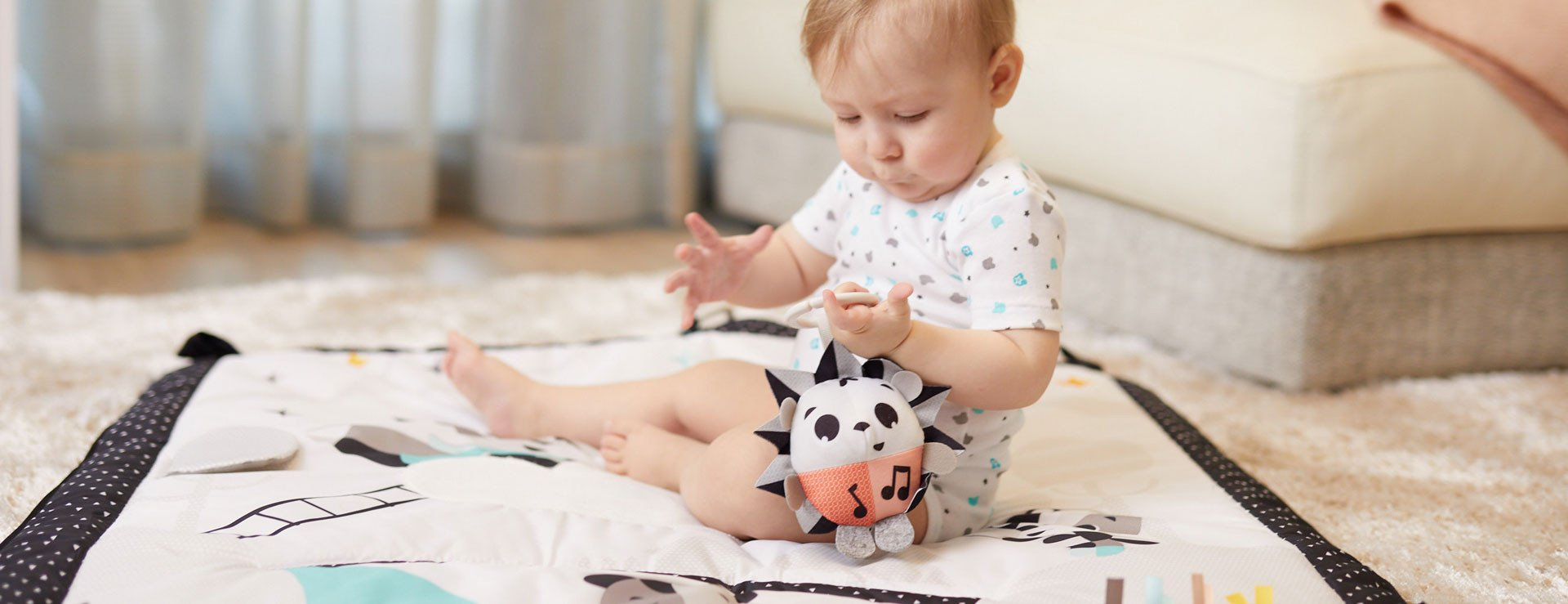 Musical toy responds to tapping, teaching baby about cause & effect