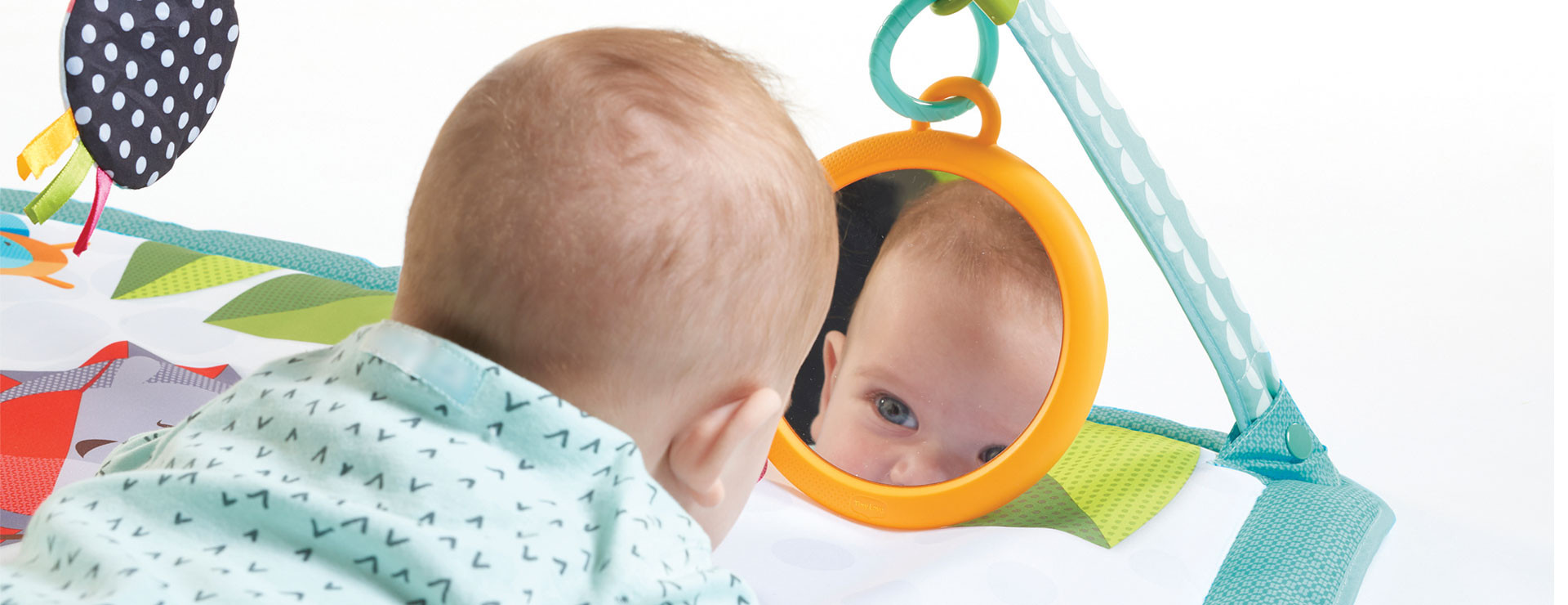 Comfortable mat and engaging mirror promote extended tummy time