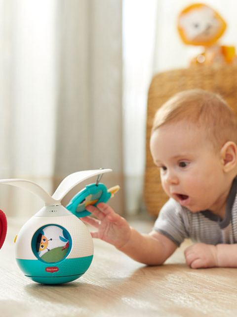 Hanging toys and peek-a-boo windows keep baby stimulated and on their tummies longer